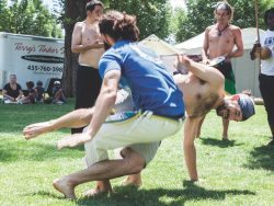 Two Volta Miuda capoeira student practice their moves at Salt Lake's Pioneer Park