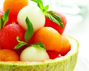 Fruit salad with melon and watermelon balls in cantaloupe bowl