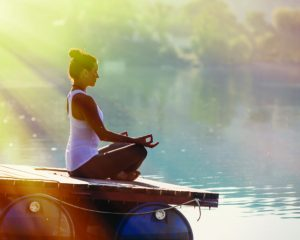 Woman Yoga - relax in nature,  Yoga woman meditatin. Woman Yoga Exercises Outdoor