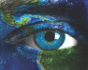 Planet earth and blue human eye