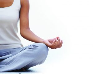 Portrait a black woman's hand while she's meditating in lotus position by copy space